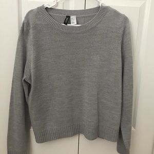 Long-sleeve knitted type material shirt.